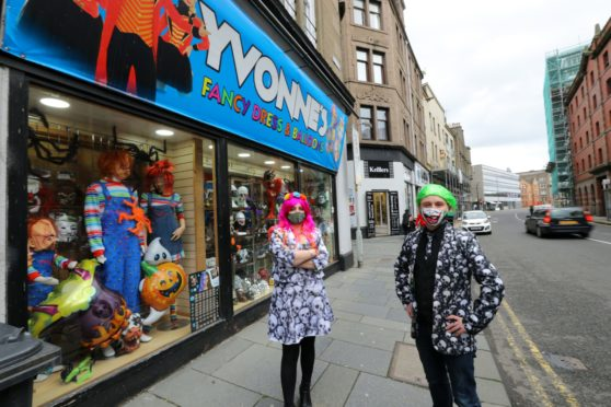David Farry, right, owner of Yvonne's Fancy Dress shop in the Seagate in Dundee, with manageress Mandy Napier.