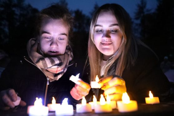 Courier Dundee news CR0024483 & 24427 G Jennings pics , National baby and infant loss awareness month, a candle lit vigil was held in Birkhill cemetery in memory of babies who have died, Jade Watt who remembered baby Neylan Angus & Ellie De -Gernier who remembered baby Jonathon Rennie, thursday 15th october.