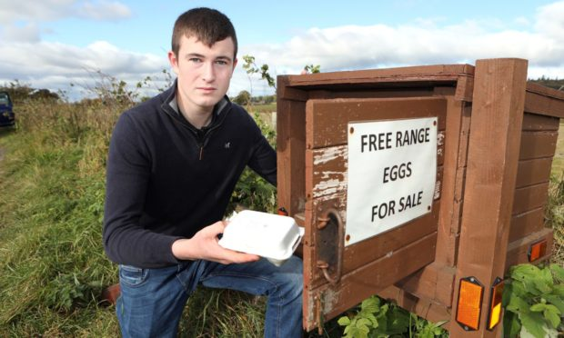 Fraser Dandie, 17, from Hatton of Carse near Forfar with his egg honesty box which had all the eggs stolen from it. Photo by Gareth Jennings/DCT Media
