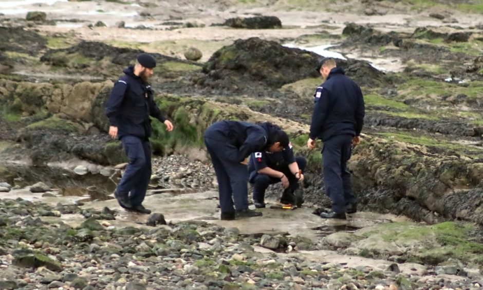 The EOD team deal with the device on Carnoustie Beach.