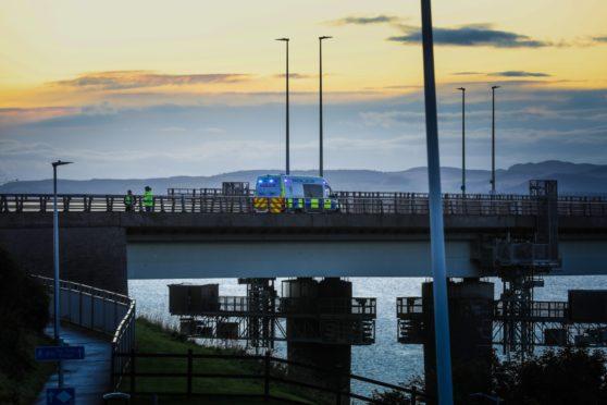 Police on the bridge on Monday evening.
