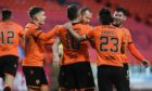 Dundee United players celebrate second goal against Ross County on Saturday.
