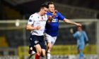Dundee's Cammy Kerr battles with Mitch Megginson of Cove Rangers at Dens Park.