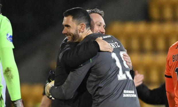 Dundee United boss Micky Mellon celebrates with keeper Deniz Mehmet.