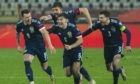 Ryan Jack, Declan Gallagher, Kieran Tierney and captain Andy Robertson celebrate Scotland penalty shootout success in Serbia and Euro 2020 qualification.