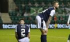 Dundee players are dejected after falling behind at Hibernian.