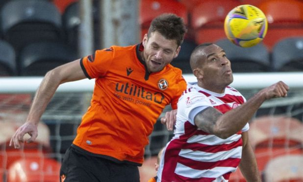 Dundee United defender Ryan Edwards (left) in action against Hamilton.