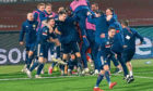 The Scotland team celebrate qualifying for their first major championships in 22 years.