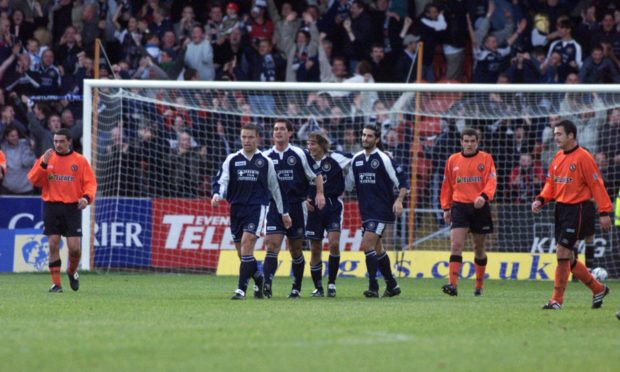 Players' faces tell the story after Claudio Caniggia's goal put Dundee ahead in the city derby in 2000.