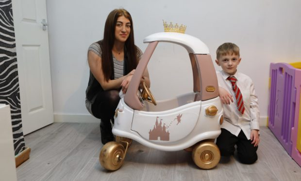 Heather Greenwood and her son Rory Wallace with the upcycled car.