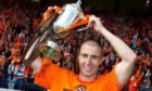 Sean Dillon proudly holds the Scottish Cup aloft in 2010.