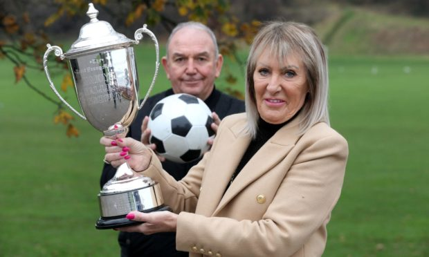 Peter Marr brings back the Zamoyski Trophy in memory of Dave Young to be competed by the  Dundee Walking Football League. Peter  Marr & Sandra Young (Dave's wife) with the trophy.