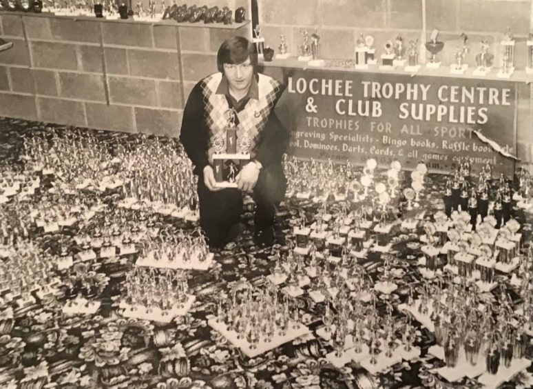 Dundee Sunday Welfare AFA match secretary Jim Don with the amount of trophies purchased for the end-of-season awards.