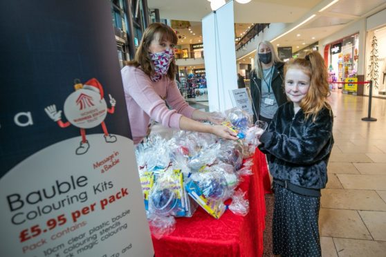Angie De Vos, Paige Jackson, 9, and Stacey Wallace at Overgate Shopping Centre.