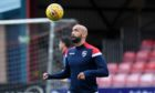 Former Ross County defender Liam Fontaine has signed for Dundee.