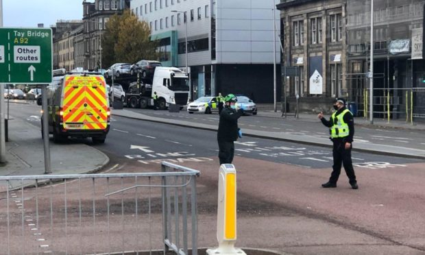 Police and the ambulance service at the scene yesterday.