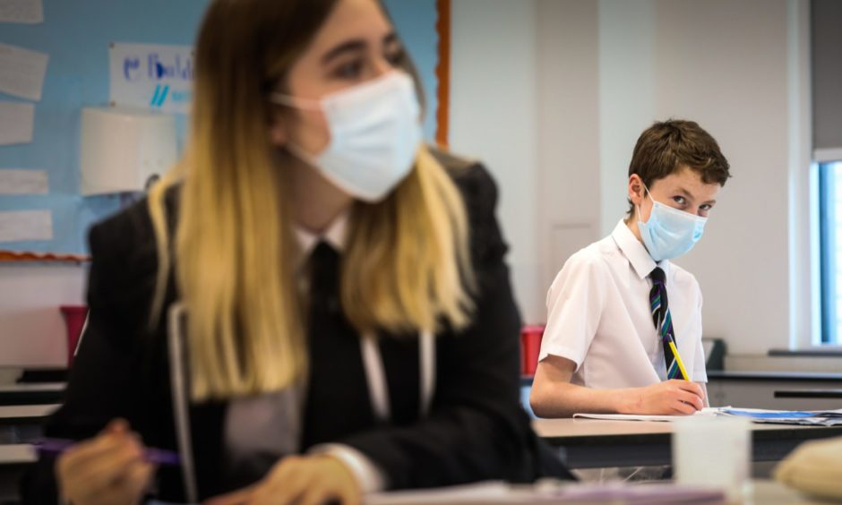 Pupils in chemistry lesson wearing their face masks.
