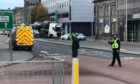 Police Scotland have sealed off a busy section of road.
