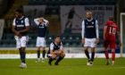 Dundee players dejected at full-time against Dunfermline.