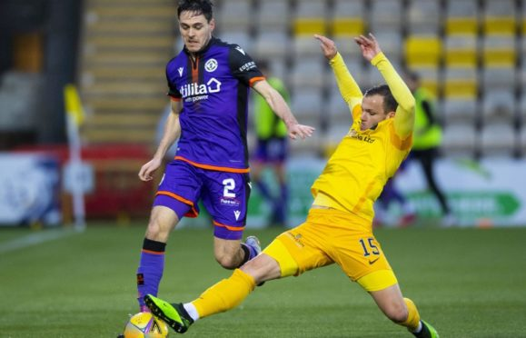 Dundee United's Liam Smith and Livingston's Matej Poplatnik.