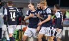 Dundee's Paul McGowan (centre) celebrates his winning goal against Arbroath.