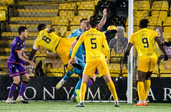 Marvin Bartley (No 6) makes it 2-0 to Livi.