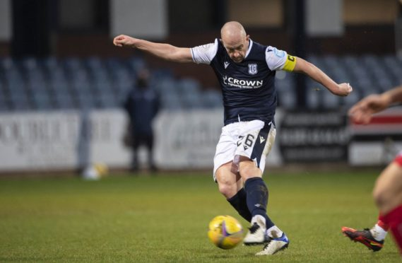 Charlie Adam smashes Dundee in front against Dunfermline but picked up an injury late in the game.