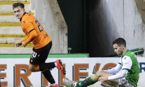 Luke Bolton wheels away after netting at Hibs.