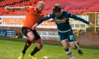 Dundee United defender Mark Connolly challenges Motherwell striker Callum Lang.
