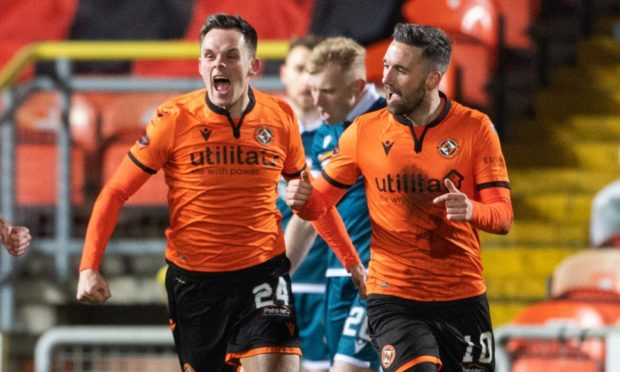 Dundee United strikers Lawrence Shankland and Nicky Clark celebrate their equaliser against Motherwell.