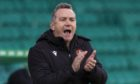 Micky Mellon urges his team on at Celtic Park.