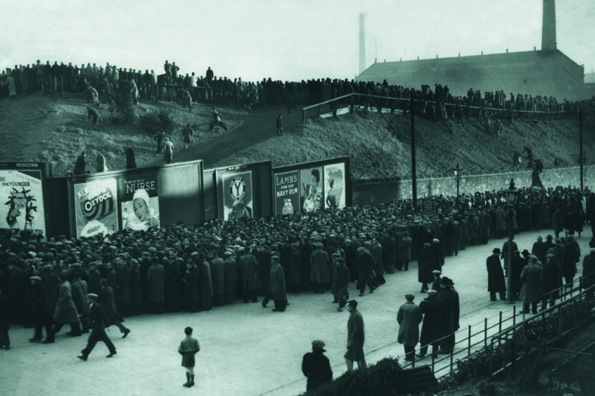 Fans gather for Dundee vs Rangers in 1949.