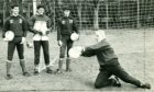 In the 1980s, Dundee European Cup goalie Bert Slater returned to Dens, assisting Jocky Scott with keeper coaching. Here he shows up-and-coming goalkeepers (from left) Bobby Geddes, Tom Carson and Paul Mathers how the master would do it.