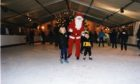 Santa takes to the ice at Dundee's open air rink with Lara Stewart and Kevin Langlands in 1998.