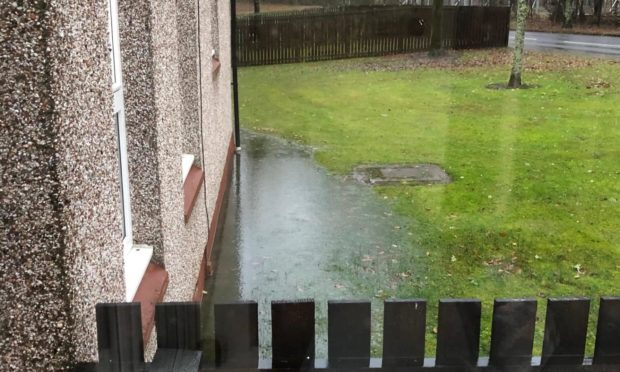 Teh ground outside the Dalmahoy Drive house floods regularly, leading to a damp smell in the OAP's home.