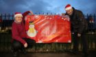 Simon Redmond & Ron Neave of Fintry Community Council with the Christmas posters.