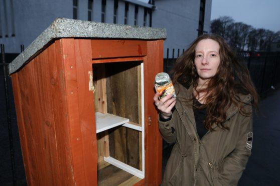 Gemma Johnsen at the damaged give and take box.