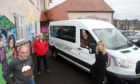 The Grey Lodge minibus was stolen and crashed into cars on a neighbouring street. Pictured are members Alan Duncan, Iain Glass, Colin Burnett (in van) and Jen McLean, with another of the organisation's vehicles.