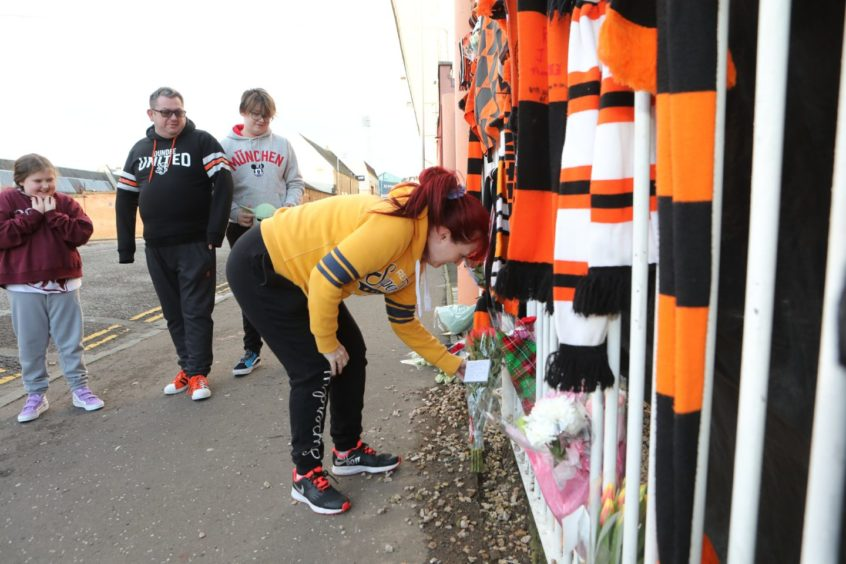 Fans pay their respect.