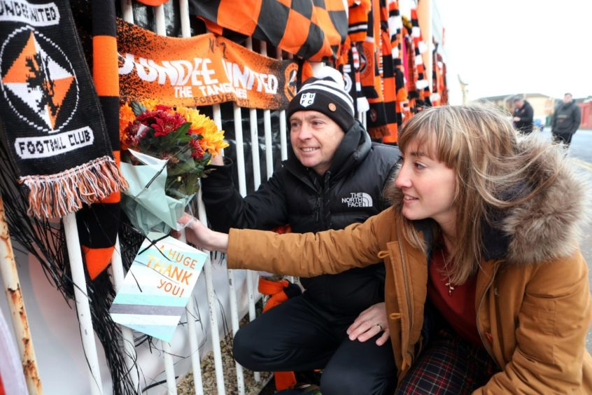 Dave Hart and Gemma Mulholland lay flowers.