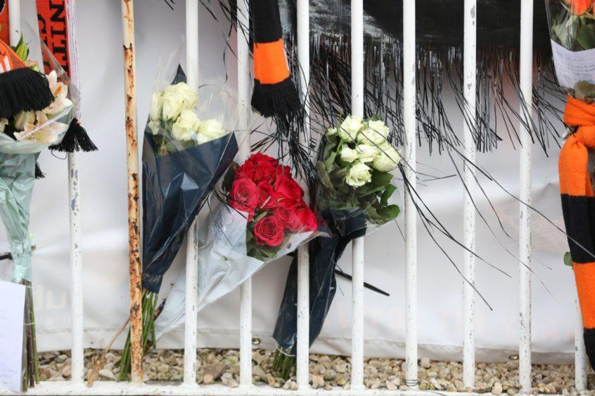 Flowers left by fans.