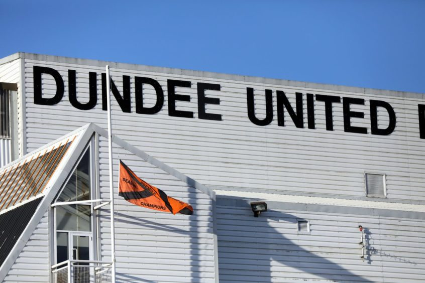 The flag at Tannadice at half mast.