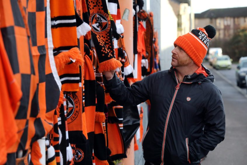 A number of scarves were left by fans.