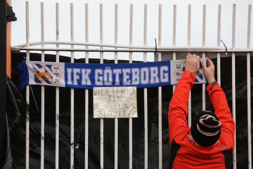 A Gothenburg scarf is put up by one fan.
