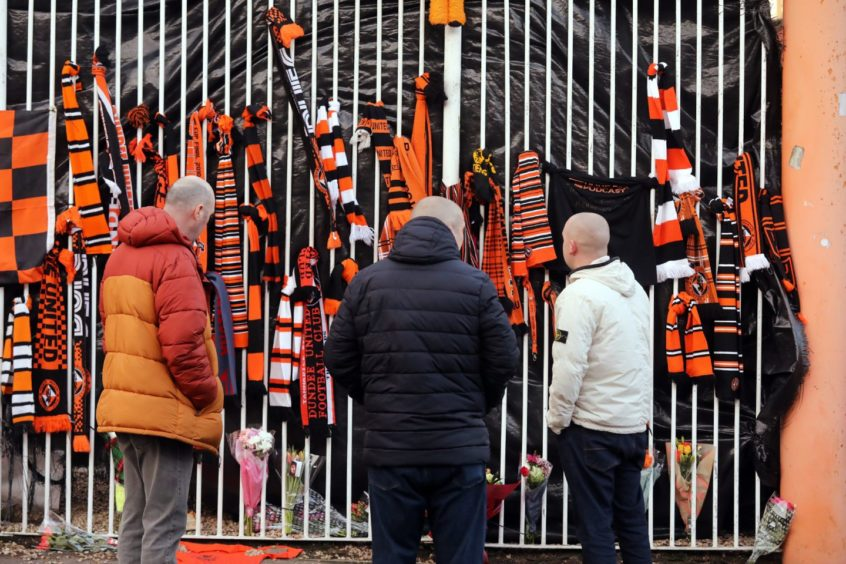 Fans gathering yesterday to pay their respects.