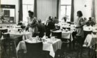 Businessmen relax over a meal in the Val D'Or restaurant, City Square.