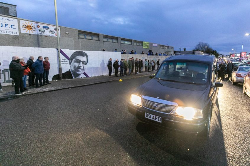 The funeral cortege pauses at the home of Violet Junior Football Club.