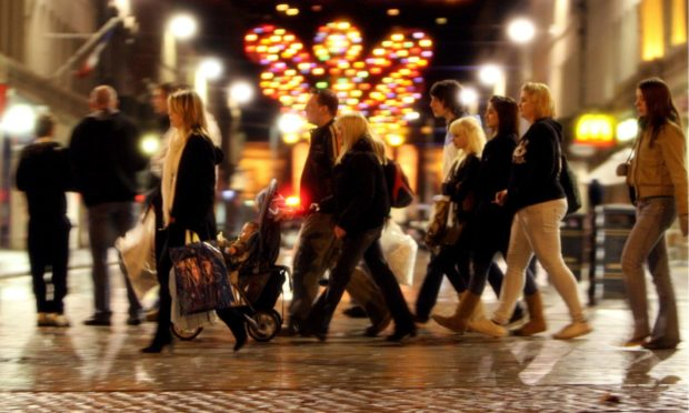 Mad dash! Shoppers leaving it late for Christmas shopping in Dundee city centre in 2007.