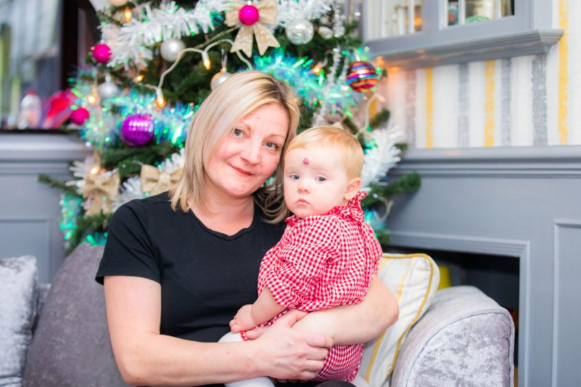 Terri Lewis and one-year-old daughter Riva
