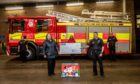 Firefighters at Blackness Fire Station in Dundee have donated £1,000 to city clothing charity Togs. Pictured are Pam Glass; Leigh Esposito (rear) Laura Collins, Jill Smith of Togs and Paul Kinghorn.